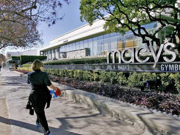 A walker and her dog go past the Macy's Store on S. Lake Ave. in Pasadena. This store will remain open while the Paseo Colorado Macy's Store on E. Colorado Blvd. will close.