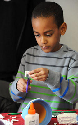 Justin Ewan 6, of Allentown works on his 3-D relief sculpture during the Hunt for History Club at the Moravian Museum in Bethlehem, sponsored by the Historic Bethlehem Partnership Saturday afternoon.
