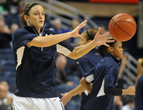 UConn's Kelly Faris warms up before facing Notre Dame at Gampel Pavilion Saturday afternoon.