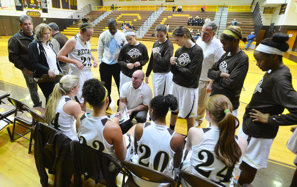 Bethlehem Catholic's girls basketball team gathers around head coach Bill Lanscek during a girls high school basketball against East Stroudsburg South held at Bethlehem Catholic High School on Saturday.