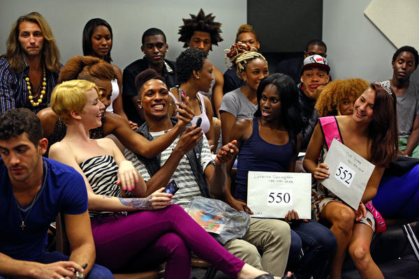 Participants joke around and take photos of themselves while waiting for a casting call for America's Next Top Model held at The Art Institute of Ft. Lauderdale.