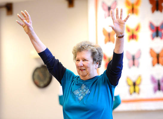 Line dancing student Marian DeLong of Catasauqua raises her arms in a dance class lesson. Beginning Line Dance class at the Lehigh County Senior Center was held Saturday.
