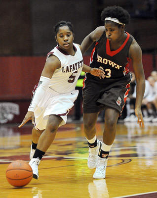Lafayette's Brya Freeland (left) dribbles away from Brown's Sheila Dixon during their college women's basketball game Saturday afternoon.