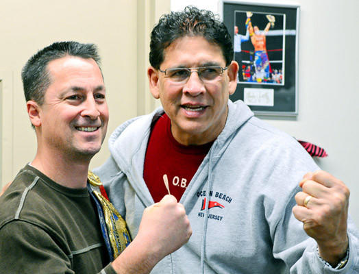 Tito Santana, right, poses with fan Michael Kish of Coplay. Santana was in Allentown at Merchant's Square to sign autographs for his fans.