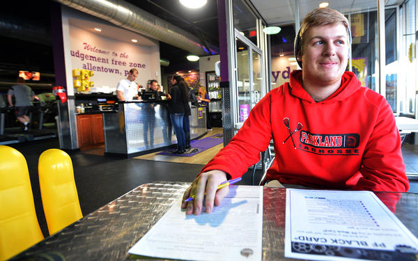 Ian O'Brien, of Orefield signs up at Planet Fitness in Allentown. His New Years Resolution is be become healthier, stronger, and lose some weight. New Years Resolutions bring an influx of runners and lifters to the gym every January.