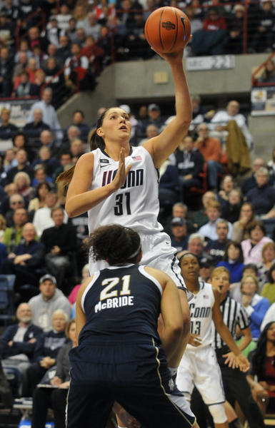 UConn's Stefanie Dolson shoots over Notre Dame's Kayla McBride at Gampel Pavilion Saturday afternoon.