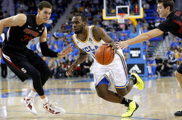 UCLA swingman Shabazz Muhammad splits the defense of Stanford's Dwight Powell, left, and Rosco Allen in the second half Saturday.