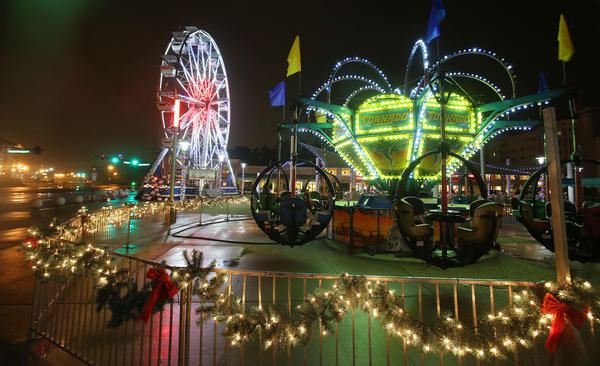 Light Up UCF: 50 nights of lights, music and ice is pictured at the UCF Arena on Friday, January 4, 2013. Rides, including a ferris wheel, musical light show and ice-skating rink are included in the festivities!