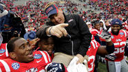BIRMINGHAM, Ala. -- Bo Wallace threw three touchdown passes to lead Mississippi to a 38-17 victory over Pittsburgh in the BBVA Compass Bowl on Saturday, completing an impressive turnaround under first-year Coach Hugh Freeze.