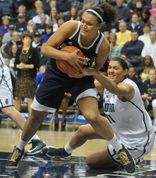UConn's Stefanie Dolson and Notre Dame's Kayla McBride in action at Gampel Pavilion Saturday afternoon.