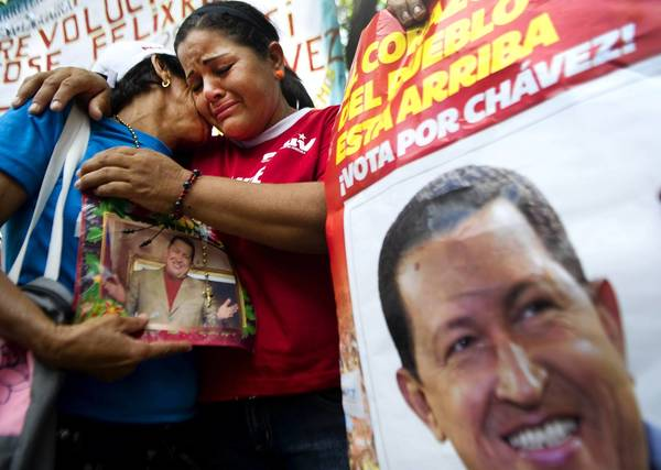Supporters of Venezuelan President Hugo Chavez gather outside the National Assembly in Caracas. The leader is being treated for cancer in Cuba and details of his condition are not known.
