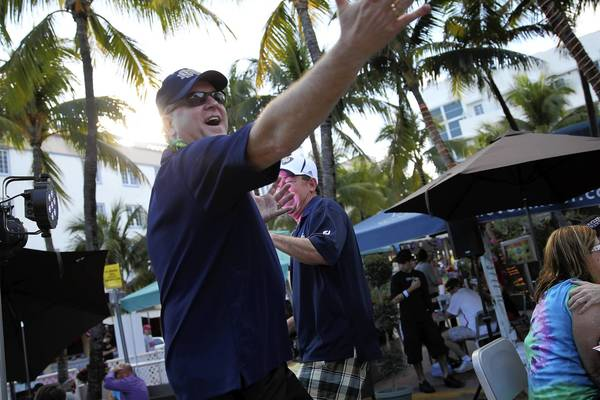 Notre Dame fans dance at The Clevelander as they enjoy the festivities leading up to the 2013 BCS National Championship Game on South Beach in Miami, Florida.