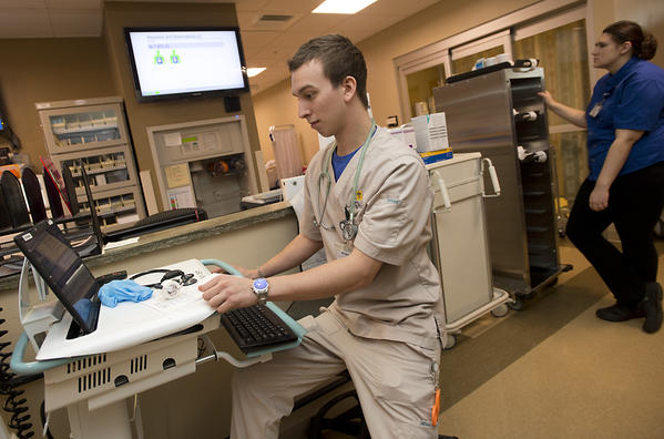 Patient Care Assistant Michael Angelino works in the Emergency Department at the Luke's University Hospital, Anderson campus in Bethlehem Twp. on Thursday. St. Luke's University Health Network now is doubling the size of the emergency department at its Anderson campus, which is all of 14 months old.
