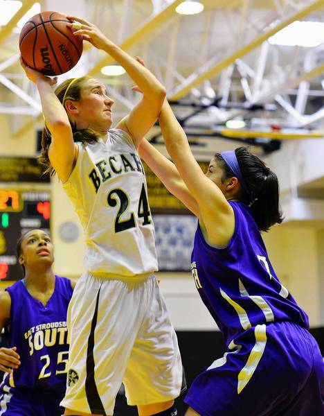 Bethlehem Catholic's Bridget Smith (24) looks to score against East Stroudsburg South's Lisa Steakin (3) during a girls high school basketball game held at Bethlehem Catholic High School on Saturday.