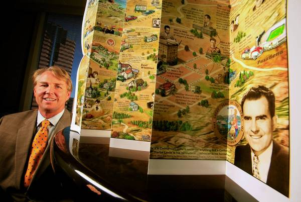 "Paul Carter with his map, ""Native Son Richard Nixon's Southern California: My Life on a Map!"" It sells for $4.99 at the Nixon Presidential Library & Museum in Yorba Linda"