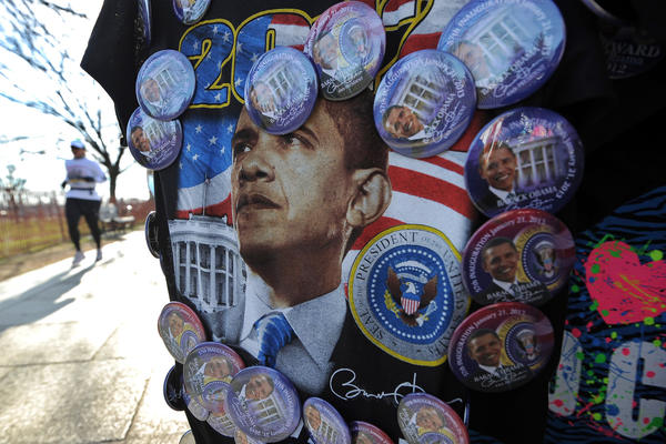 A woman jogs past a roadside souvenir stall displaying T-shirt with US President Barack Obama's picture in Washington, DC, on January 5, 2013. Preparations are underway for Obama's second inauguration which will take place with a public ceremonial oath of office on January 21, 2013.
