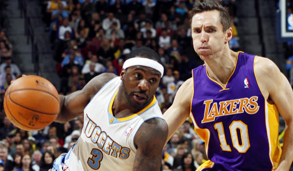 Denver guard Ty Lawson drives Steve Nash during the Nuggets' 126-114 victory over the Lakers last month.