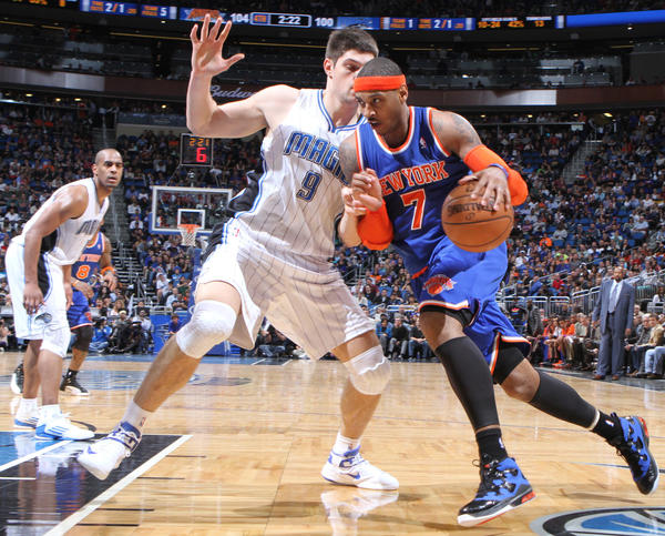 New York forward Carmelo Anthony drives against Orlando center Nikola Vucevic (9) during the Knicks 114-106 victory over the Magic in Orlando, Fla.