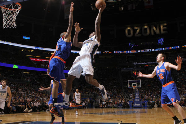 Orlando forward DeQuan Jones (20) shoots over New York center Tyson Chandler (6) during the first half of the Magic's game against the  Knicks in Orlando, Fla.
