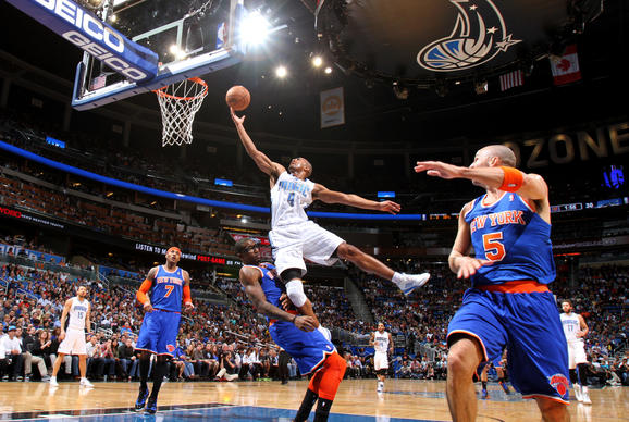 Orlando guard Arron Afflalo (4) draws the charge from New York center Amar'e Stoudemire (1) during the first half of the Magic's game against the  Knicks in Orlando, Fla.