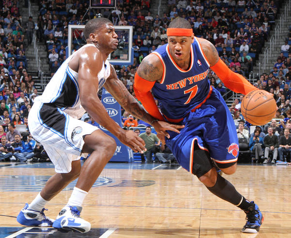 New York forward Carmelo Anthony (7) drives against Orlando forward DeQuan Jones (20) during the second half of the Knicks 114-106 victory over the Magic in Orlando, Fla.