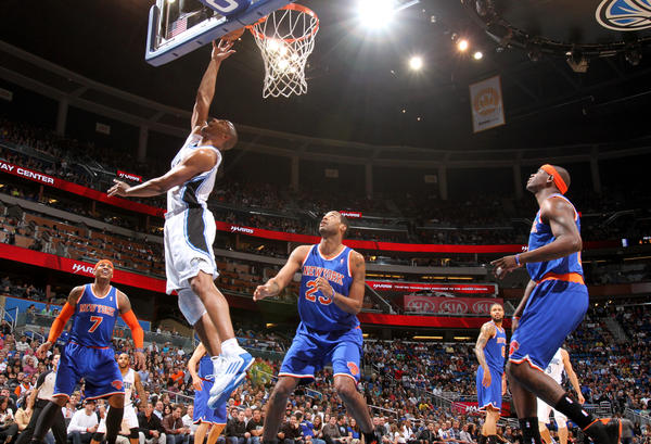 Orlando guard Arron Afflalo (4) puts in a reverse layup during the first half of the Magic's 114-106 loss to the New York Knicks in Orlando, Fla.