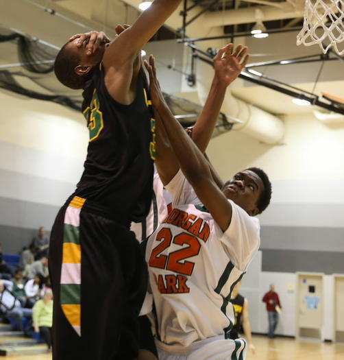 Normal U-High's Keita Bates-Diop is fouled by Morgan Park's Alonzo Chatman on Saturday.