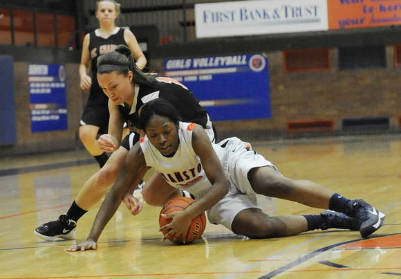 Evanston's Seara Clayborn (bottom) and St. Charles East's Carly Pottle go for the ball during a game in Evanston on Saturday.