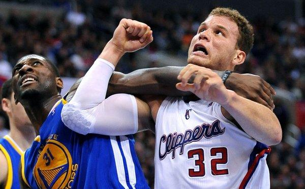 Clippers forward Blake Griffin and Warriors' Festus Ezeli battle for position.