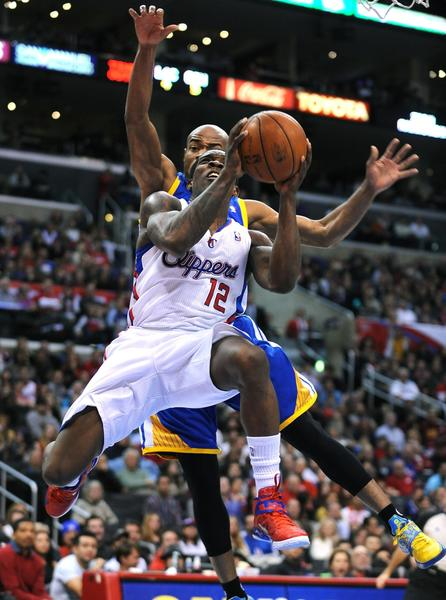 Clippers guard Eric Bledsoe drives past Warriors' Jarrett Jack for a basket.