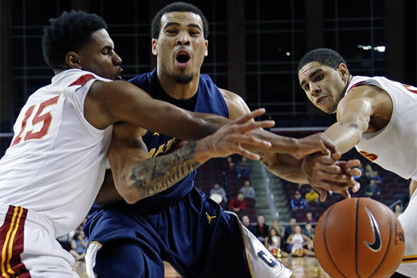 California guard Justin Cobbs tries to break through the defense of USC guard Brendyn Taylor and forward Aaron Fuller during the Trojans 72-64 loss Saturday night.