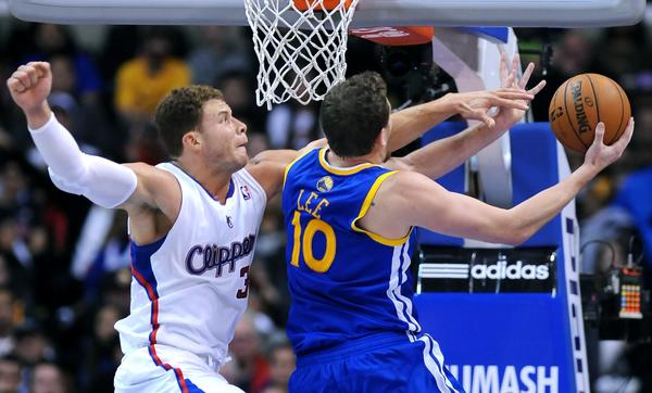 Clippers forward Blake Griffin tries to block Warriors forward David Lee's shot.