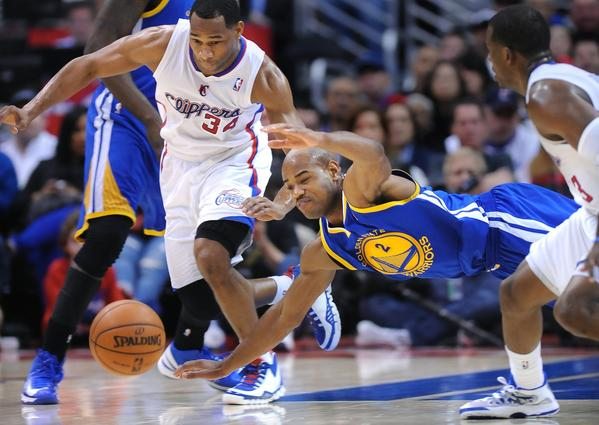 Clippers guard Willie Green, left, and Warriors' Jarrett Jack battle for a loose ball.