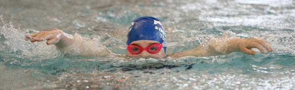 Makenna Tucker of the Aberdeen Swim Club peeks out of the water as she competes in the girls 8 and under 50-yard butterfly event Saturday at the Aberdeen Winter High Point Meet at the Aberdeen Family YMCA.
