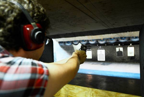 A shooter uses his Smith & Wesson handgun at the Los Angele Gun Club.