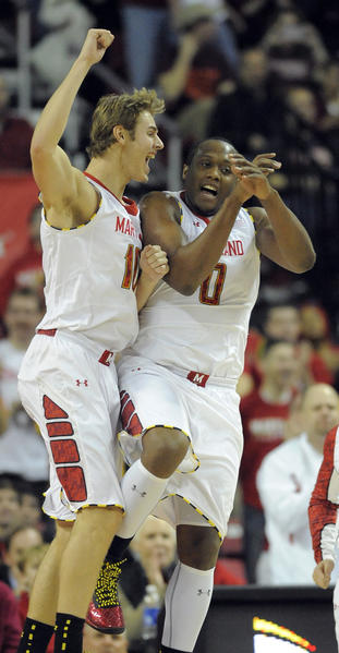 The Terps' Jake Layman, left, and teammate Charles Mitchell celebrate a basket by Layman in the first half. The University of Maryland men's basketball team topped Virginia Tech Hokies at the Comcast Center, 94-71.