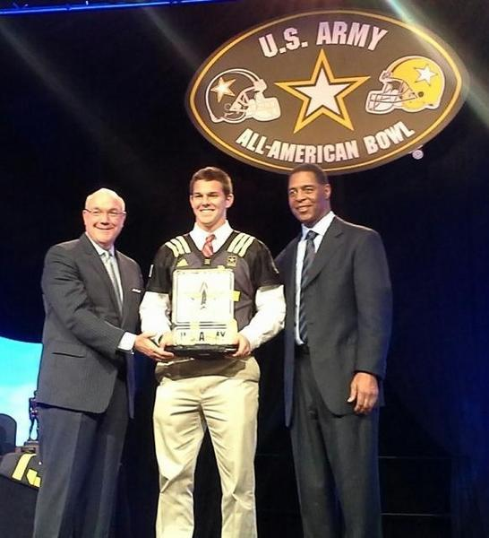 Orlando Boone High punter and Ohio State commit Johnny Townsend is presented with the 2013 Doc Blanhchard Award at the U.S. Army All-American Bowl in San Antonio, Texas. With Townsend at right is Pro Football Hall of Famer Marcus Allen.