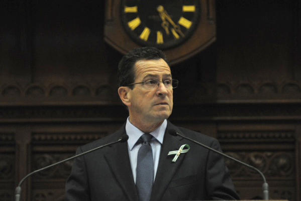 Governor Dannel Malloy delivers an address during a tribute to the Newtown shooting victims at the state capitol.