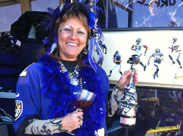 Marquetta Sullivan tailgates outside her purple van with a Ravens wine bottle holder and other items. Sullivan says she'll be cheering for Ray Lewis on Sunday in his final home game.