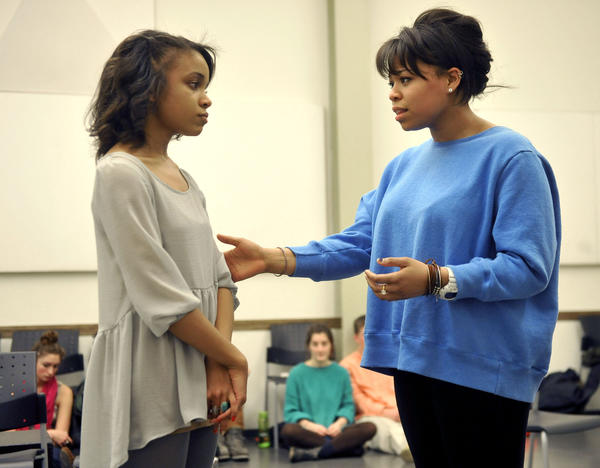 "Rachel Hilson, 17, left, as ""Rachel"" a fire victim, and Isabella Boose, 18, as the doctor, rehearse ""After the Fire,"" a play to teach elementary and middle schoolers about fire safety. The Baltimore School for the Arts teams up with the American Red Cross to put on the play."