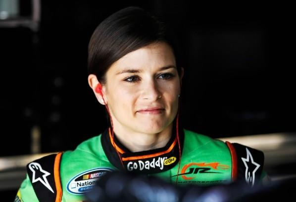 Danica Patrick stands in the garage during practice for the NASCAR Nationwide Series Ford EcoBoost 300 at Homestead-Miami Speedway on November 16, 2012 in Homestead, Florida.