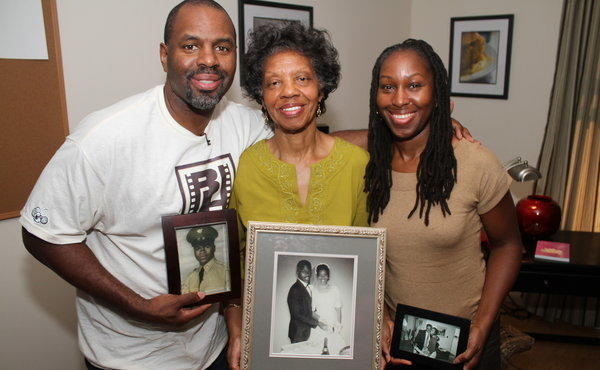 Byron Hurt, left, with his mother and sister and photos of his dad. He probed the origins and effects of soul food in a new PBS film.