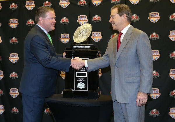 Notre Dame coach Brian Kelly (left) shakes hands with Alabama Crimson Tide coach Nick Saban on Sunday.