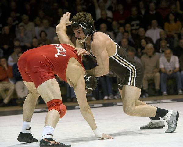 Lehigh's Robert Hamlin (right) defeated Cornell's defending national champion, Steve Bosak, at 184 pounds.