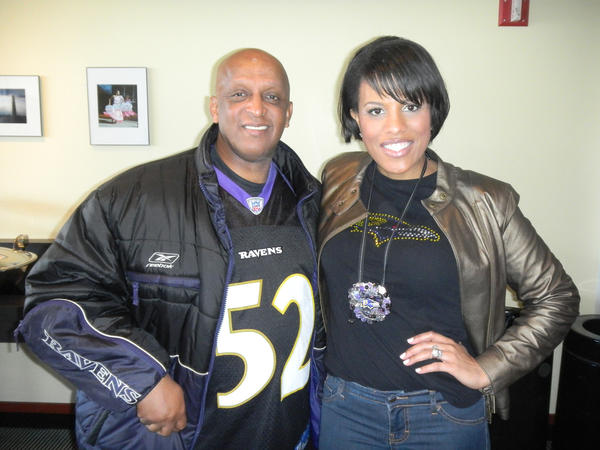 "Baltimore City Council President Bernard ""Jack"" Young and Mayor Stephanie Rawlings-Blake proudly display their team spirit in the mayor's suite. The mayor wore a Ravens-themed pendant made by a local artist, that - on the reverse side - could double as a bottle opener. ""Which can come in handy - occasionally - at a Ravens game,"" she said."