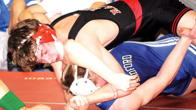 Meyersdales Billy Dunbar wrestles Bedfords Caleb Grimes in a match at 170 pounds at the Everett Bloody Run Duals on Saturday. Dunbar defeated Grimes, 14-3.