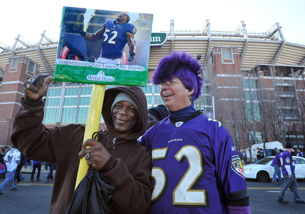 Ray Lewis fans Arthur Mack, left, of Baltimore, and Bucky Buchanan, right, of Annapolis pose for a photo.