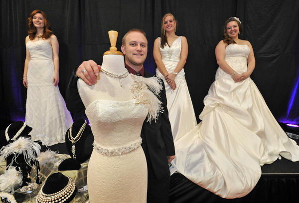 Chris Moore of K&B Bridals of Bel Air, with models, from left, Stephanie Testerman, Elizabeth Johnson and Lindsey Pritchett.