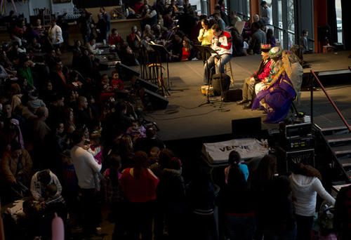 The three kings (left to right ) Nelson Matos, William Cintron, and Ramon Rodriguez, are on stage as their story is read as people take part in the Three Kings Day celebration at SteelStacks on Sunday.