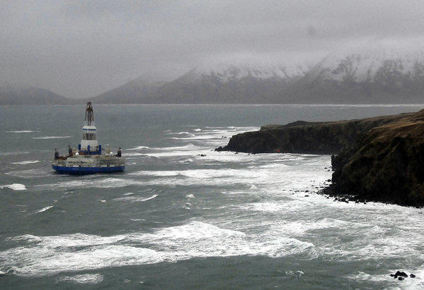 The Shell drilling rig Kulluk aground off a small island near Kodiak Island. Weather may affect retrieval efforts.